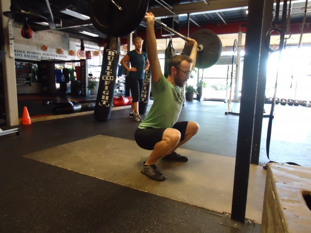 Chris Overstreet at the bottom of an overhead squat